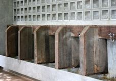 Old urinal on wooden wall Royalty Free Stock Photography