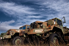 Old US Army Trucks. A series of old military trucks rusting in a field Royalty Free Stock Images