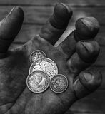 Old US coins in hand black and white stock image