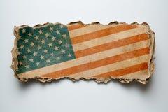 Old USA flag on cardboard piece Stock Image