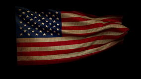 Old USA flag is developing rapidly in the wind. + alfa. Loop animation stock footage