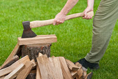 Old used ax with a log Royalty Free Stock Image