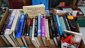 Old used books in a box outside an antique book shop. Antiquarian book shop with secondhand books for sale outside in Eton High Street near Windsor Berkshire stock images