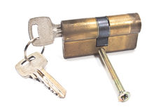 Old used brass cartridge cylinder with keys Stock Photo