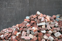 Old Used Bricks. A pile of old used chipped bricks selection royalty free stock photography