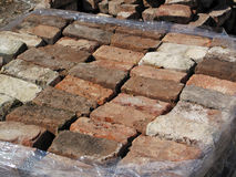 A Old Used Bricks. A stacked pile of old used sorted bricks wrapped in clear plastic stock photos