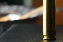 Old used bullet shell scene. Old used bullet shell scene represent weapon concept Stock Photo