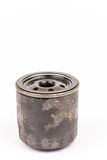 Old used car oil filter isolated over white background Stock Image