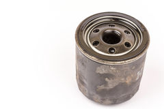Old used car oil filter isolated over white background Royalty Free Stock Image