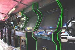 Old used classic forgotten Vintage Arcade in room and none of players playing video games in the frame. Game machine cabinet with. Pixel screen and colorful royalty free stock images