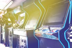 Old used classic forgotten Vintage Arcade in room and none of players playing video games in the frame. Game machine cabinet with. Pixel screen and colorful royalty free stock image