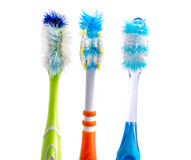 Old used colorful toothbrushes Royalty Free Stock Photos