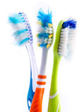 Old used colorful toothbrushes Stock Photos