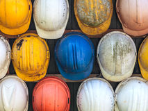 Old used construction helmets Stock Photos