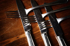 Old used cutlery  on dark wooden table.  Royalty Free Stock Images