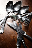 Old used cutlery  on dark wooden table.  Stock Photos