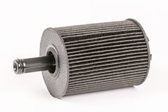 Old used and dirty car fuel filter isolated above white backgrou Royalty Free Stock Image