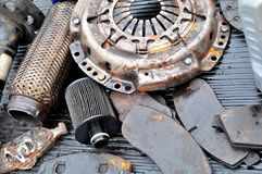 Old used dirty car parts. Stock Photo
