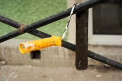 Old used dirty paint roller hanging royalty free stock images
