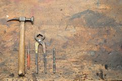 Old used dirty workbench with tools. Stock Photography