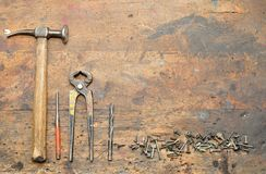 Old used dirty workbench with tools. Royalty Free Stock Photography
