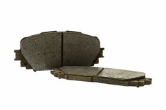 Old used disc brake pad (automobile spare part). Isolated on white background Royalty Free Stock Photos