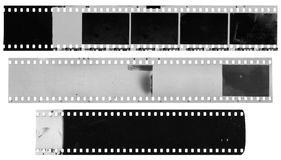 Old, used, dusty and scratched celluloid film strips. Old, used, dusty and scratched black and white celluloid film strips isolated on white background Stock Photography
