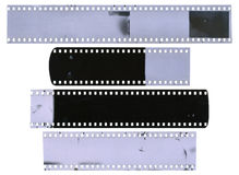 Old, used, dusty and scratched celluloid film strips Stock Image