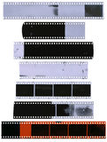 Old, used, dusty and scratched celluloid film strips. Isolated on white background Royalty Free Stock Photo