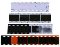 Old, used, dusty and scratched celluloid film strips royalty free stock photos