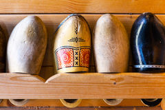 Old used dutch wooden shoes or clogs in Holland Stock Photo