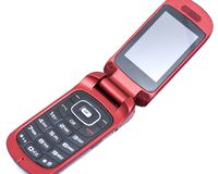Old used flip cell phone isolated on white. Background stock image