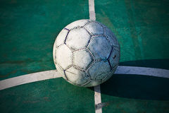 Old used football or soccer ball Stock Images
