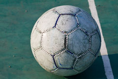 Old used football or soccer ball Stock Photography