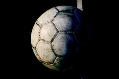 Old used football or soccer ball on cracked asphalt Stock Photography