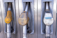 Old used gas pump nozzles Stock Image