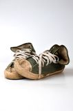 Old used green sneakers. On white background Stock Photo