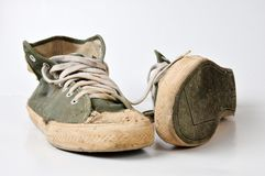 Old used green sneakers. On white background Royalty Free Stock Photography