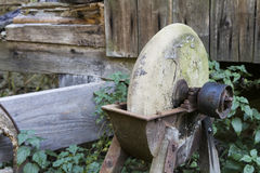 Old, used grinding stone Stock Photos