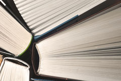 Old and used hardback books or text books seen from above. Books and reading are essential for self improvement, gaining knowledge Royalty Free Stock Photos
