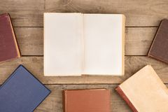 Old hardback books or text books on wooden table. Old and used hardback books or text books on wooden table royalty free stock photo