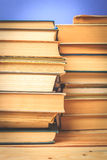 Old and used hardback books. Or text books seen from above royalty free stock image