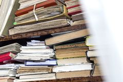 Old and used hardback books or text books seen from above. Books and reading are essential for self improvement, gaining knowledge royalty free stock images