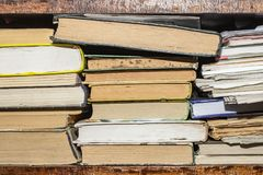 Old and used hardback books or text books seen from above. Books and reading are essential for self improvement, gaining knowledge royalty free stock photography