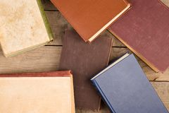 Old hardback books or text books on wooden table. Old and used hardback books or text books on wooden table stock photography