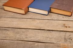 Hardback books or text books on wooden table. Old and used hardback books or text books on wooden table royalty free stock image