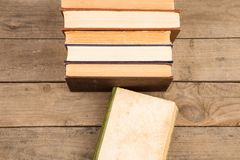 Old hardback books or text books on wooden table. Old and used hardback books or text books on wooden table stock photo