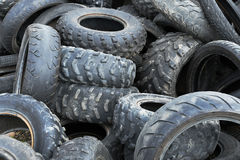 Old Used Industrial Tires. An abstract image of a pile of old used and abandoned industrial tires Stock Images