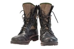 Old used jungle boots Stock Images