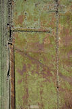 Old used metal door background Royalty Free Stock Photography